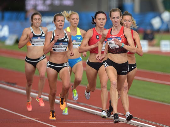 Molly Huddle (right) leads the pack during the women's