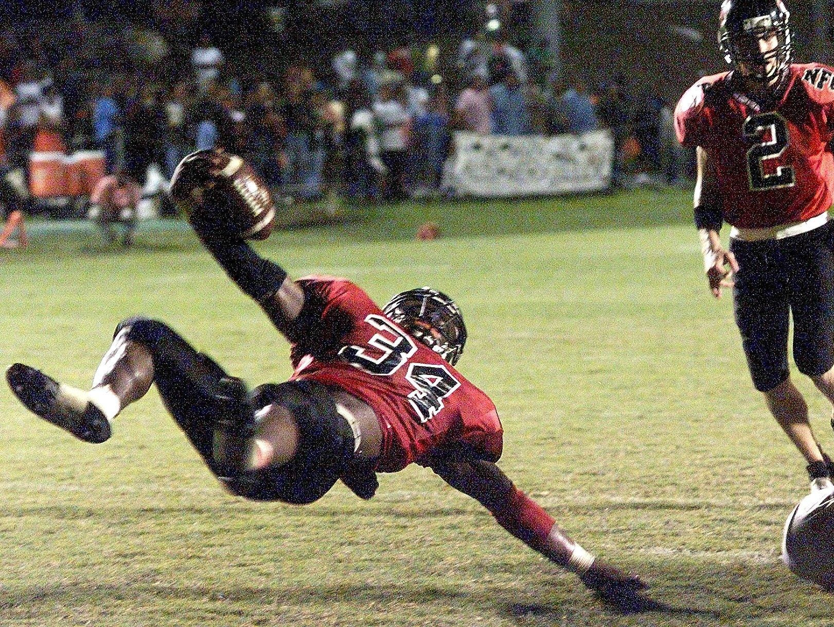 NFC running back Ernie Sims flips towards the endzone in the first half of a game in 2001.