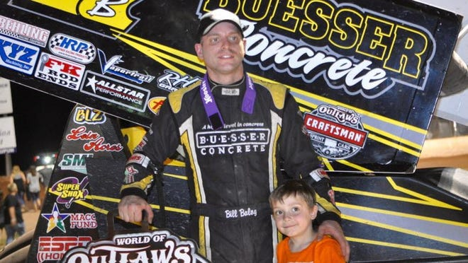 """Bill Balog of Hartland poses with his older son Dylan, 5, after winning the 2016 edition of the World of Outlaws Jim """"JB"""" Boyd Memorial race  at Beaver Dam."""