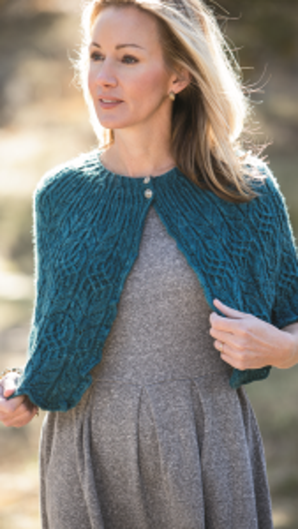 "This cape, called the ""Plumage Wrap,"" appears in the Spring  2014 issue of Interweave Knits. It's shown here with permission from F&W, and is available on the Interweave website for $7.99: bit.ly/1mmCngG"