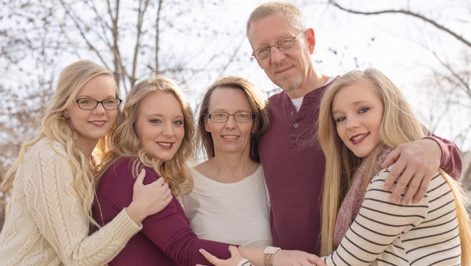 Karla (Goeldner) Rathjen, center, in a family photograph. From left: daughters Miranda and Deena; husband, Todd; and daughter Chelsie.