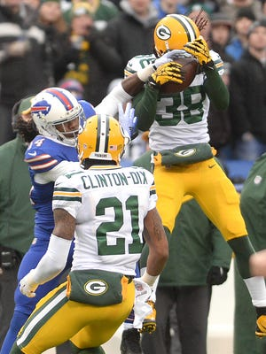 Green Bay Packers cornerback Tramon Williams (38) makes an interception in front of receiver Sammy Watkins (14) against the Buffalo Bills at Ralph Wilson Stadium in Orchard Park, N.Y., December 14, 2014.