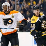 Marchand has 2 goals, 3 assists and Bruins pound Flyers 6-3