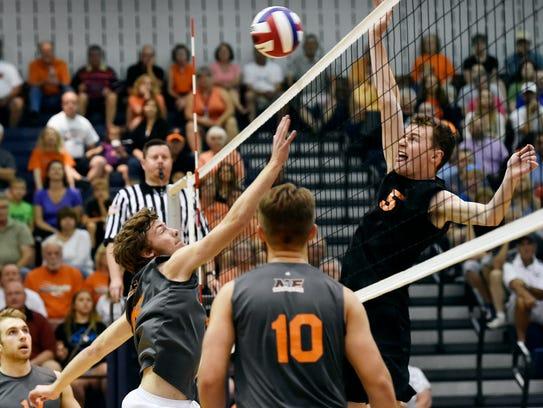 Northeastern's Dakoda Hoffman defends against a spike