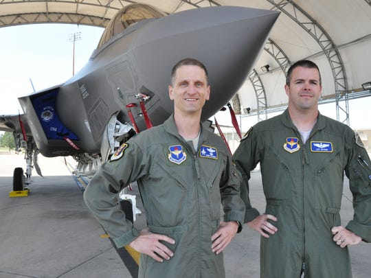 Lt. Col. Randal Efferson (left) and Maj. Jay Spohn stand in front of the Air Force's newest fifth-generation fighter jet at Eglin Air Force Base, Fla., May 11, 2012. The Florida Air National Guardsmen are the only National Guard pilots currently assigned to the 33rd Operations Group and they'll soon be taking to the skies to master the F-35 Lightning II Joint Strike Fighter.