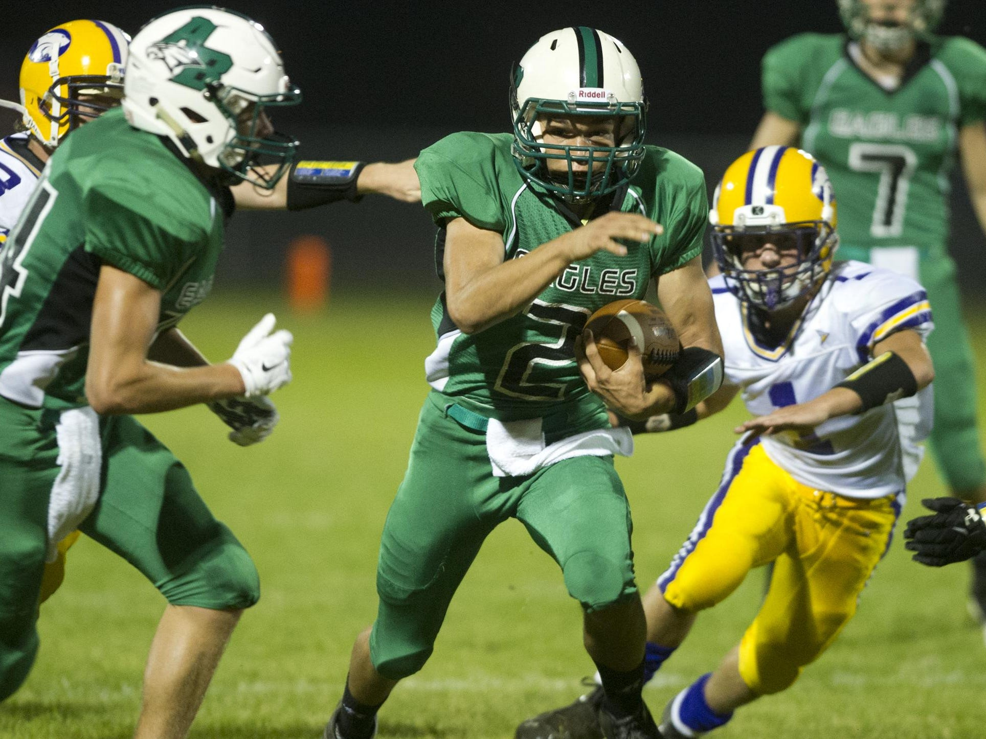 Almond-Bancroft's Derek Baumgartner (2) runs with the ball during the Central Wisconsin Conference football game against Wild Rose in Almond, Friday, Sept. 25, 2015.
