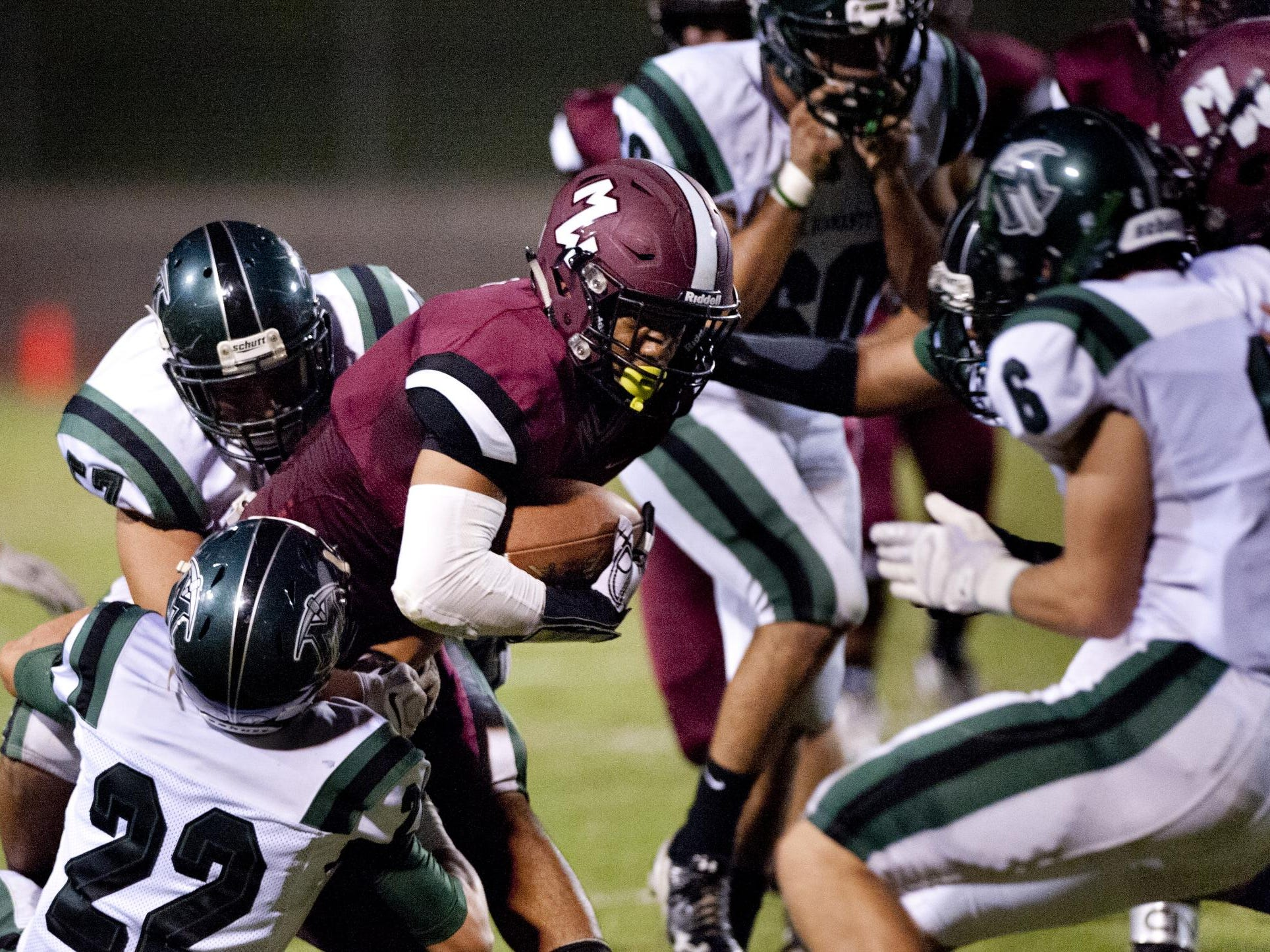 Mt. Whitney's Tyler Boss plows through El Diamante defenders in a West Yosemite League at Mineral King Bowl.