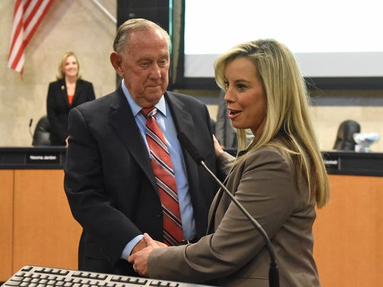 Mayor Bob Cashell listens as incoming mayor Hillary Schieve talks after she was sworn in as the new mayor during the city council on Nov. 12, 2014.