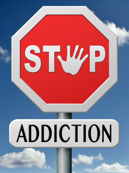 Stop Addiction road signs in red, white, and black