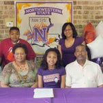 Opelousas High senior Sydney Stewart is surrounded by family members Thursday as she prepares to sign a track scholarship with Northwestern State. The ceremony at the Crawfish Corner in Opelousas was also attended by selected friends and classmates. Pictured with Stewart are Murphy Guillory, Jr., Murphy Guillory, Sr., siblings Phillip and Brittany Stewart, mother Johanna Stewart, father Raymond Stewart and OHS track coach Kenneth Winfrey.