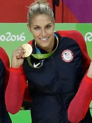 Elena Delle Donne shows off her gold medal on Saturday.