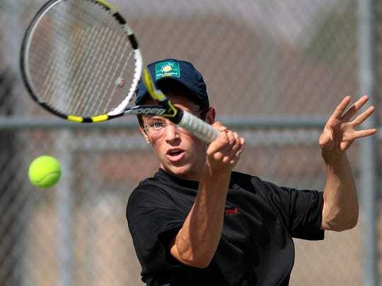 Palm Desert High School's Ethan Weiss returns the ball to Joey Herrera of Indio High School during a boys varsity tennis match on Tuesday, April 7, 2015 at Indio.