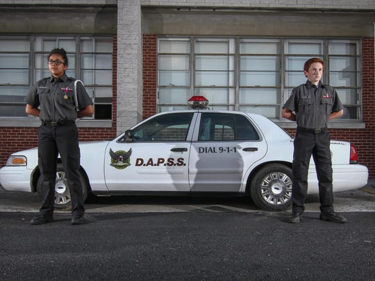 Delaware Academy of Public Safety and Security students Janelly Salazar, 15, (left) and Joshua Ritter, 14, are shown June 1 in New Castle. The program is a charter school.