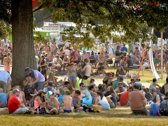 Guest stay cool in the shade at the Bonnaroo Music