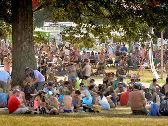 Guest stay cool in the shade at the Bonnaroo Music and Arts Festival, Sunday, June 12, 2016, in Manchester, Tenn.