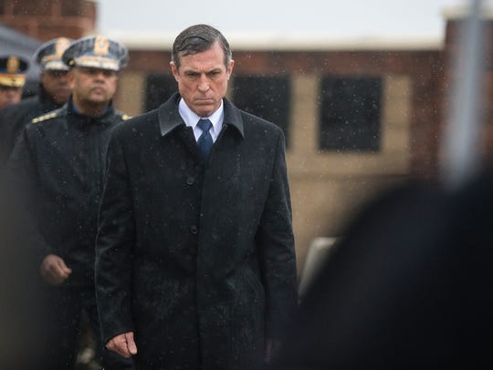 Governor John Carney walks towards a memorial plaque for Lt. Steven R. Floyd Sr. during a memorial ceremony for Floyd Sunday afternoon at James T. Vaughn Correctional Center.