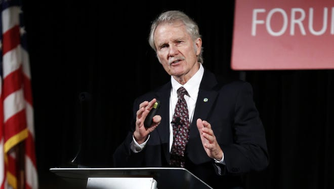 Former Oregon Governor Dr. John Kitzhaber speaks to a crowd during a luncheon organized by the Salem Area Chamber of Commerce Monday, Oct. 9, 2017, in Salem, Oregon.