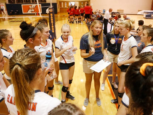 Harrison head coach Mandy Johnson with instructions for her players between games against Frontier Tuesday, August 22, 2017, in West Lafayette. The Harrison swept Frontier 25-13, 25-16, 25-13.