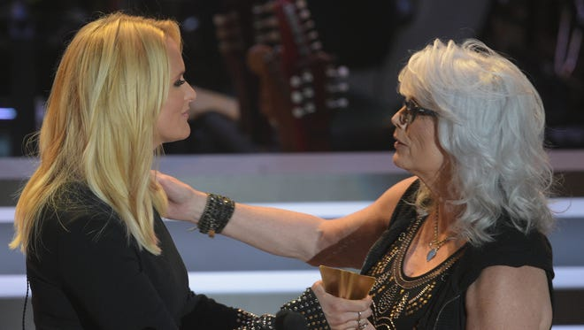 Miranda Lambert receives the Merle Haggard Spirit Award from Emmylou Harris at the 10th annual ACM Honors on Tuesday, Aug. 30, 2016, at the Ryman Auditorium in Nashville.
