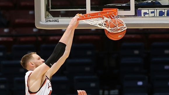 UTEP center Matt Willms stuffs the ball as Andrew Drone, 54, of Rice watches Thursday in Birmingham, Alabama.