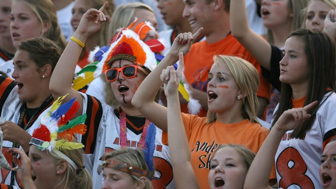 Anderson High School fans cheer for their Redskins during a varsity football game against Woodward in 2009.
