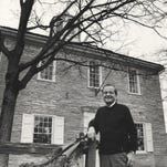 Frank O'Bannon poses outside the first state capitol building in Corydon in this 1989 file photo.