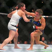 Jul 25, 2015; Chicago, IL, USA; Jessica Eye (blue gloves) fights against Miesha Tate (red gloves) during UFC Fight Night at United Center. Mandatory Credit: Dennis Wierzbicki-USA TODAY Sports