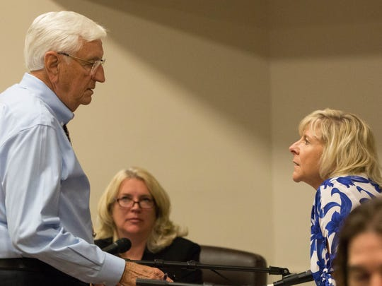 Garrey Carruthers,left, chancellor and president of New Mexico State University talks with Debra Hicks, right, chairwoman of the NMSU board of regents, before the special session meeting took place. During which the regents voted four to zero to start the search for a new chancellor. Wednesday Aug. 30, 2017.
