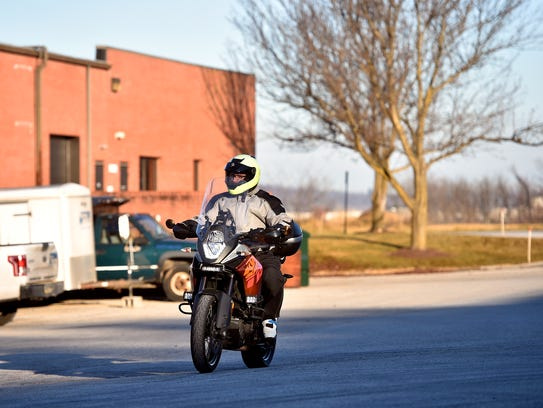Judd Hill arrives for work at the Motorcycle Technology Center of the YTI Career Institute on Dec. 21, 2017, in Manchester Township. Hill, who is the associate campus director for the Motorcycle Technology Center, has worn a helmet while riding since he walked away from a motorcycle accident more 20 years ago.