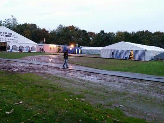 A refugee walks near a temporary camp in Stuttgart,