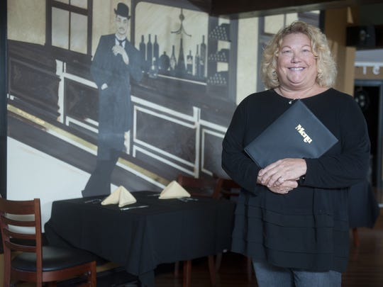 Owner Barbara Fine stands in the dining room of The Mansion House in Gloucester City.
