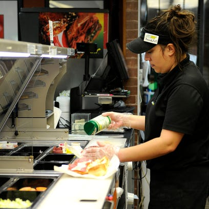 Subway Assistant Manager Amanda Alvarez makes a sandwich