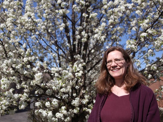 Professor Theresa Culley with the University of Cincinnati's department of biological sciences used DNA analysis to prove how the invasive Callery pear trees began spreading throughout the region.