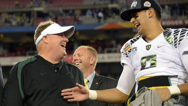 Then-Oregon coach Chip Kelly and  quarterback Marcus Mariota after the Ducks beat Kansas State in the Fiesta Bowl on Jan. 3, 2013.