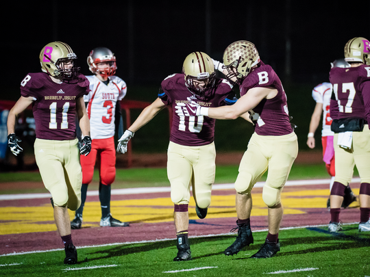 Noah Delumpa (10) is congratulated by Dillon Howell after Delumpa's touchdown vs. Southmont.