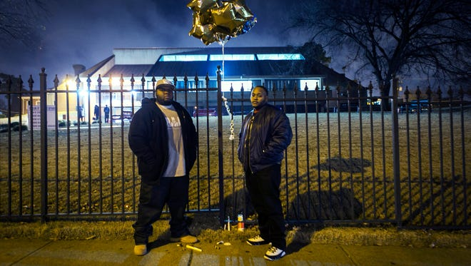 "December 14, 2016 - Former LeMoyne-Owen College students LaTavius Stewart, 22, (left) and Rashad Fair, 22, pose for a portrait at a memorial at the school for their friend Donovan Mills, 21. Stewart said Mills was ""cool, calm, collected"" and liked playing ping pong, pool, and basketball.  ""(He'd) put his headphones on and be on the skateboard going through campus,"" said Stewart. ""He helped everybody with their work. Good friend."""