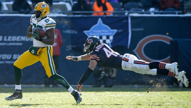 Green Bay Packers tight end Jared Cook (89) make s reception for 27 yards despite the efforts of Chicago Bears inside linebacker Nick Kwiatkoski (44) during the first  quarter of their game Sunday, December 18, 2016 at Soldier Field.