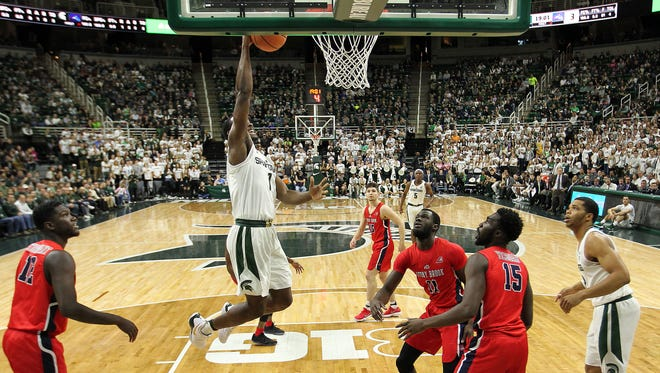 Michigan State Spartans guard Joshua Langford (1) lays the ball up against Stony Brook Seawolves guard Junior Saintel (11) during the first half a game at Jack Breslin Student Events Center.