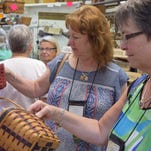 Shoppers wait in line at Stacey's Baskets and Pottery during the Buzz into Dresden event as part of the Longaberger Bee 2016 in Dresden.