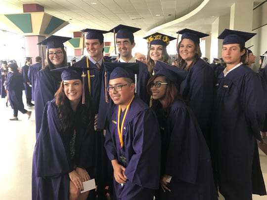Louisiana State University of Alexandria graduates pose for a photo before commencement exercises held Thursday morning.