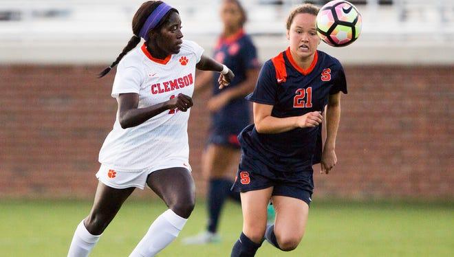 Clemson senior midfielder Catrina Atanda and Syracuse freshman midfielder Carolin Bader run after the ball during a game on Sept. 22 in Clemson.