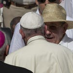 Cuba's President Raul Castro talks with Pope Francis as he arrives at the Plaza of the Revolution to celebrate a Mass, in Holguin, Cuba, in September.
