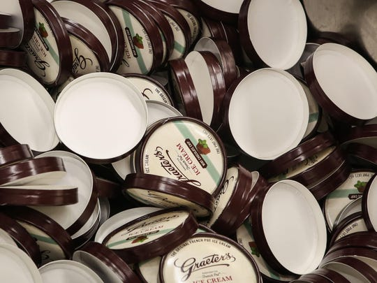 After the ice cream is mixed and frozen, mint chocolate chip is scooped into pints for packaging at the Graeter's manufacturing facility.