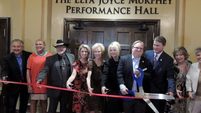 Local dignitaries join Elta Joyce Murphey McAfee, center, during the ribbon cutting ceremony at the Murphey Performance Hall at 72 W. College Ave. in downtown San Angelo on Oct. 3.