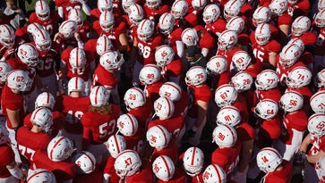 St. John's players gather in a group before the start of Saturday's homecoming game against Gustavus Adolphus at Clemens Stadium in Collegeville.