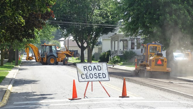 Crews repave a section of Rensselaer  Street in 2017. The city plans to spend almost $1.27 million on its 2020 mill and pave program.