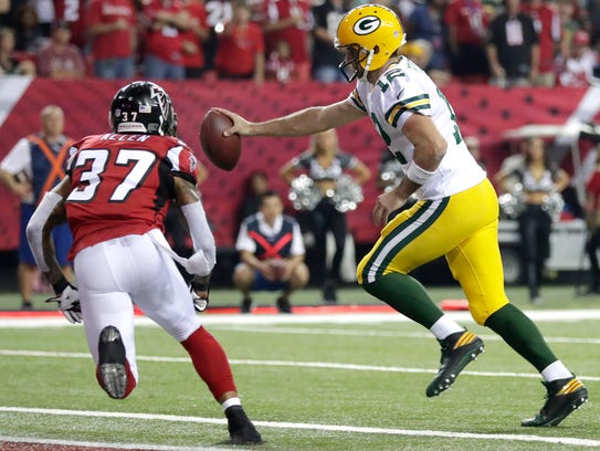 Green Bay Packers quarterback Aaron Rodgers (12)  cross