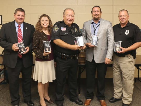 Buncombe County school officers now will have Narcan kits after receiving training Wednesday, Sept. 6. From left: Capt. Randy Smart, Buncombe County Sheriff's Office; Alice Elio, MAHEC's school health program manager; Lt. Mike Ruby, Buncombe County Sheriff's Office, Jesse Smathers, specialty populations clinical director at Vaya Health; and Sgt. Michael Murphy, Buncombe County Sheriff's Office.