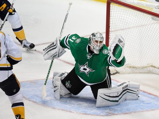 Dallas Stars goalie Antti Niemi (31) makes a save on a shot by the Nashville Predators during the third period of an NHL hockey game on Saturday, April 9, 2016, in Dallas. The Stars defeated the Predators, 3-2, to win the Central Division title. (AP Photo/Michael Ainsworth)