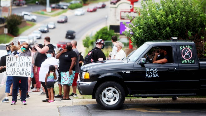 Dozens of Black Lives Matter protesters and counter-protesters gathered along 76 Country Boulevard in Branson near Dixie Outfitters. The store, which sells items with Confederate symbols, has become a target of protesters.
